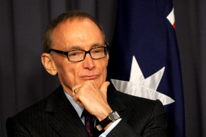 Former NSW premier Bob Carr listens at a press conference with Prime Minister Julia Gillard in Canberra, Friday, March. 2, 2012. Ms Gillard announced that Mr Carr would take the vacant senate seat and become foreign minister of Australia. (AAP Image/Alan Porritt) NO ARCHIVING