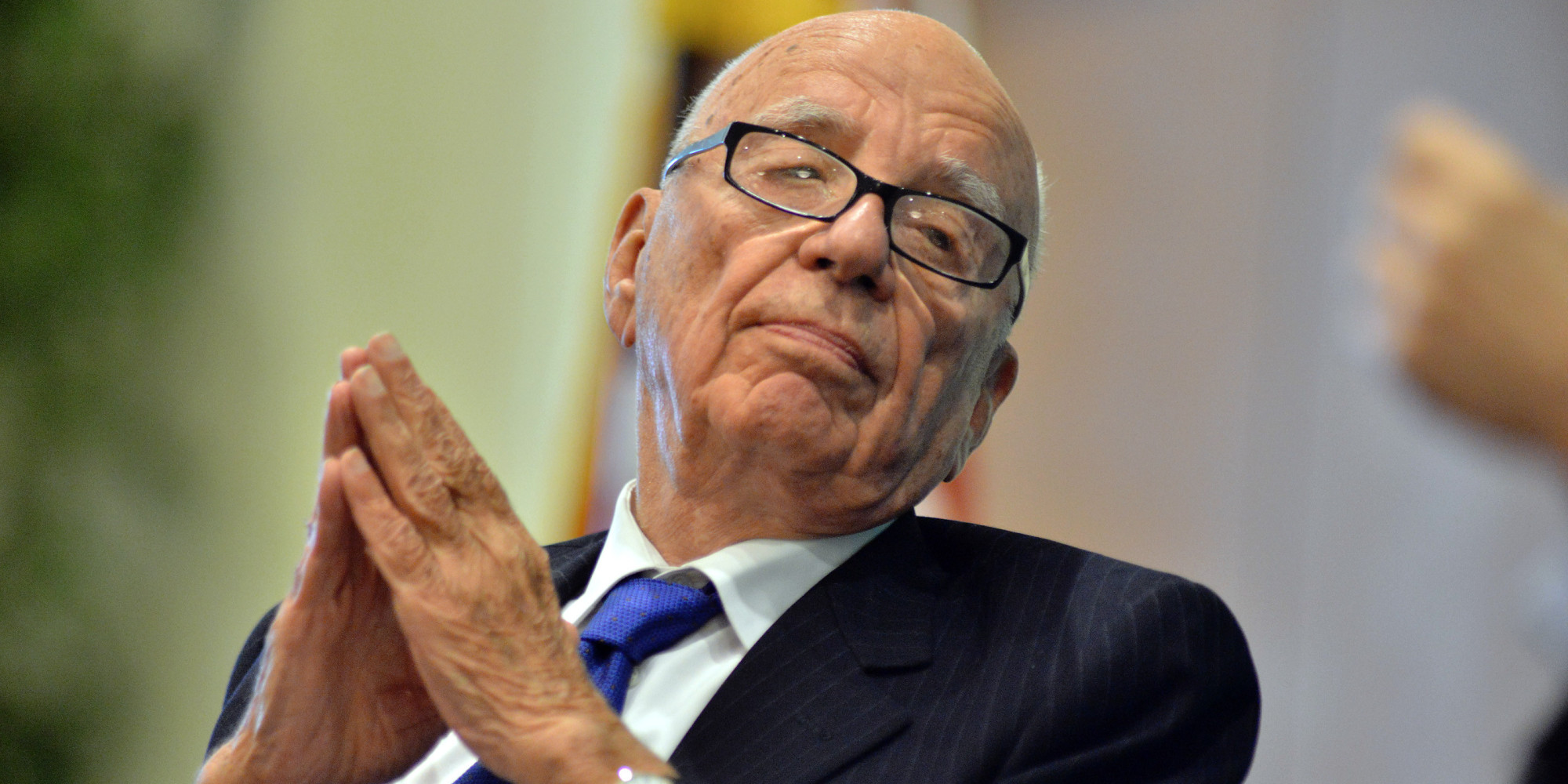News Corporation CEO Rupert Murdoch listens during a forum on The Economics and Politics of Immigration where Murdoch and New York Mayor Michael Bloomberg spoke to a business organization In Boston, Tuesday, Aug. 14, 2012. (AP Photo/Josh Reynolds)
